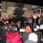 Singing carols around the Christmas Tree