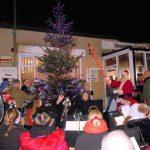 Santa lighting the Christmas tree